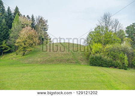 Cross on a hill above Solina lake shore (Bieszczady mountains, Poland)