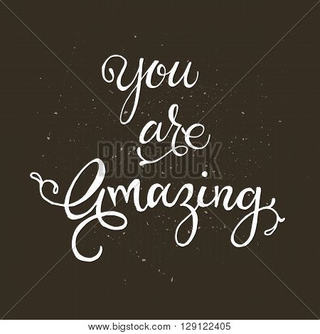 Handwritten vector lettering phrase You are awesome. Brush lettering calligraphy style writing. Whimsical letters on dark chalkboard looking scratched textured surface.