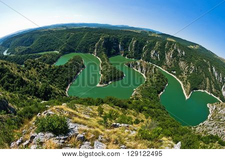 Meanders at rocky river Uvac gorge on sunny morning, southwest Serbia