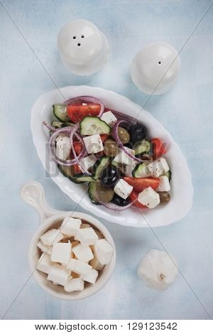 Greek salad with feta cheese, tomato, cucumber, olives and onion