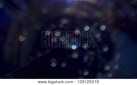 the backgrounds in dark blue colors with shimmering bokeh