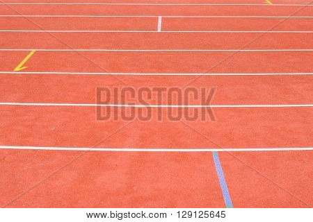 Running track in the stadium at day light