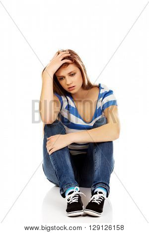 Teenage depression woman sitting on the floor