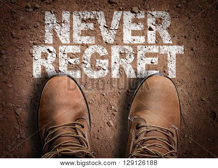 Top View of Boot on the trail with the text: Never Regret