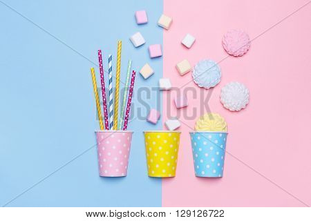 Top View of the Pastel marshmallows, meringues and cocktail tubes. Pastel background