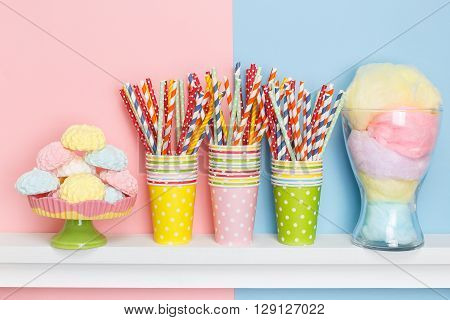 Sweets and decorations for the holiday table. Set for a birthday. Pastel background