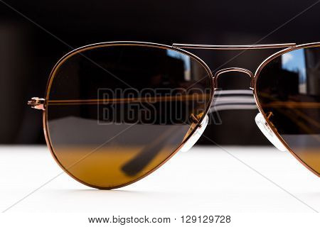 Vintage sunglasses close up on white table