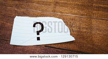 question mark against close up view of a piece of paper