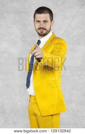 Businessman In A Gold Suit Pointing At You