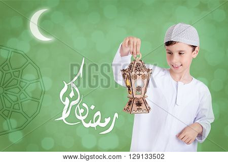 Ramadan Kareem - Translation : Muslim Holy Month Ramadan is generous - Happy young kid playing with Ramadan lantern