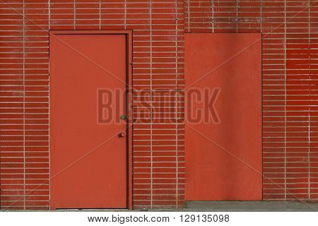 a picture of an exterior mid 20th century office brick wall with a door ** Note: Visible grain at 100%, best at smaller sizes