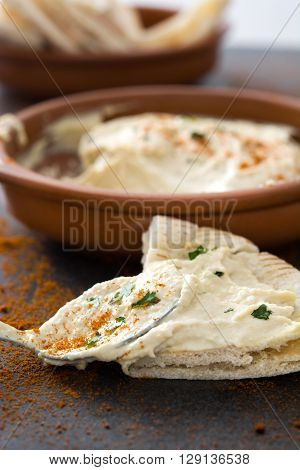 Homemade hummus and pita bread on slate