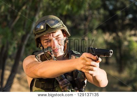 young a soldier in the uniform with weapon