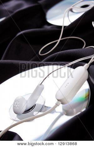 headphones over compact disc
