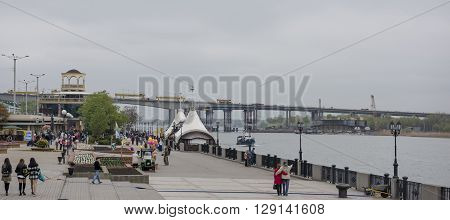 ROSTOV-ON-DON RUSSIA- MAY 01-Two bridges construction of new and repair old. Citizens walk on the waterfront on May 01 2015 in Rostov-on-Don