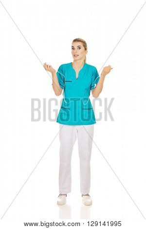 Young shocked nurse holding a drip