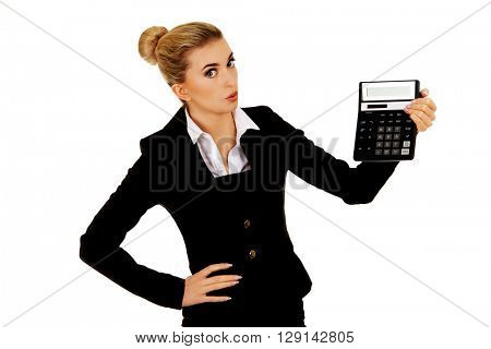 Shocked businesswoman looking at calculator