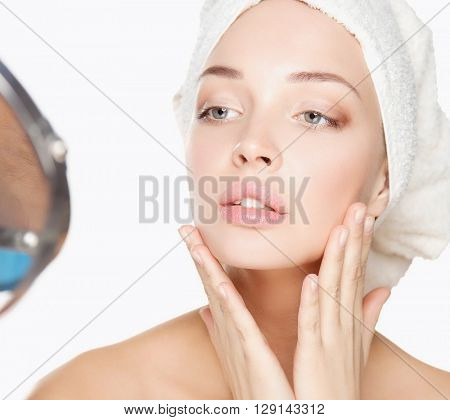 Beautiful woman with a towel on his head on a white background