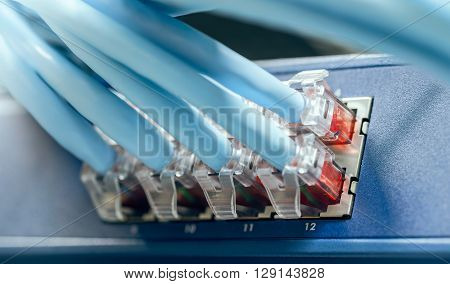 Gigabit switch with connected cables inside server rack