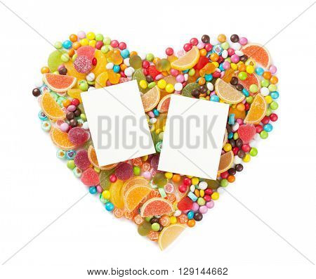 Colorful candies, jelly and marmalade heart with two photo frames. Isolated on white background