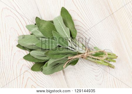 Bunch of garden sage herb on wooden table