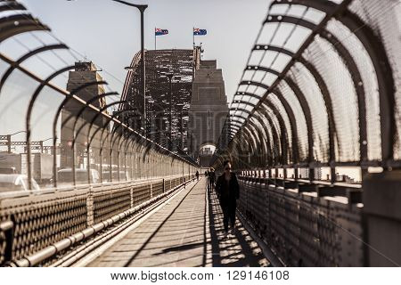 Sydney Australia - May 15 2015: People and cars crossing over the Sydney Harbour Bridge