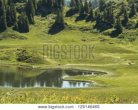 A view of the Kalbelesee lake surrounded by the Alpine mountains near village Schroecken in Bregenzerwald region Vorarlberg Austria