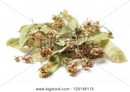 Dried linden flower Isolated on white background. The flowers resemble miniature umbrellas with yellowish color have a strong flavor and are used for making tea. Linden blossom has a disinfectant anti-inflammatory and diuretic.