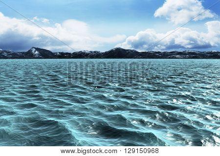 Blue ocean against blue sky
