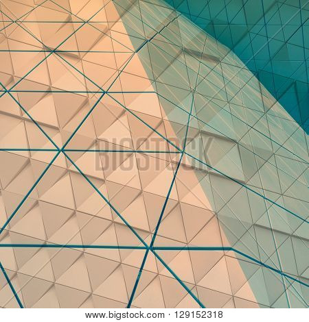 Abstract close-up view of modern aluminum ventilated facade of triangles