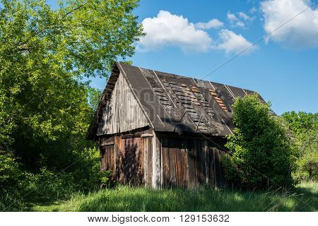 Old wooden barn with a leaky roof