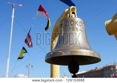 ST. PETERSBURG, RUSSIA - MAY 2, 2016: Ship's bell at the oldest operating Russian icebreaker Ivan Krusenstern during 3rd Icebreaker Festival. The label means ICEBREAKER 1964