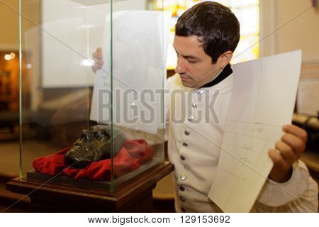 ST. PETERSBURG, RUSSIA - APRIL 27, 2016: Author of ??Suvorov. Alps. 200 years ago Alexey Egorov shows the portrait of Generalissimo A. Suvorov reconstructed by his death mask in Gerasimov laboratory
