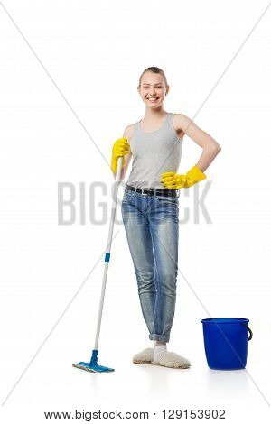 Smiling young woman with swab or swob, housewife, isolated on white