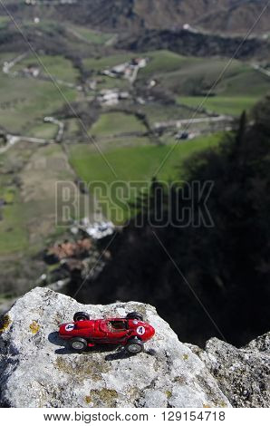 Scale model of famous red car and breathtaking panorama