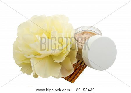 Cosmetic cream and yellow flower, spa, skincare or haircare or bodycare, isolated on white