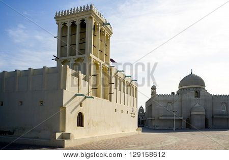 Qatar Doha a tower wind and a mosque in the old city center