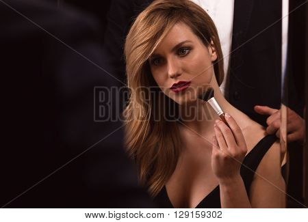 Attractive Woman With Powder Brush