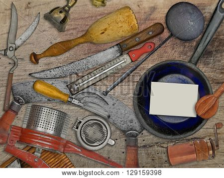 vintage utensils set for cooking over wooden table blank business card for your text