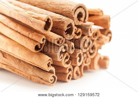 Front side view of Raw Organic Cinnamon sticks (Cinnamomum verum) isolated on white background.
