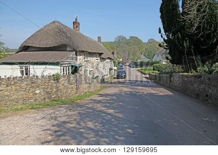 A sleepy rural village in Devon Gittisham is about as pretty as an English Village can get with thatched cottages and a small stream running through the centre.