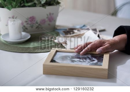 Elderly lady missing her dead husband much