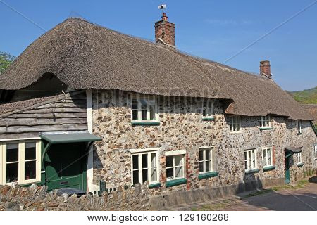 A row of thatched cottages in a Devon Village gives a taste of English Village life.