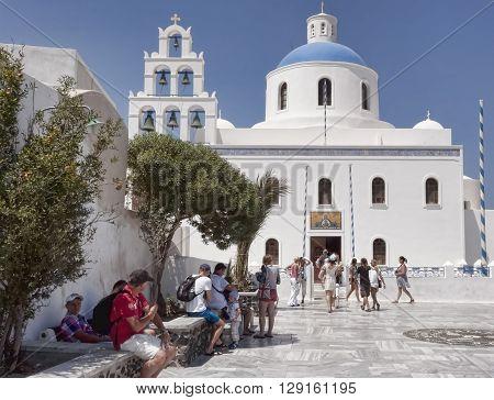 SANTORINI GREECE - AUGUST 3 2013: White-blue dome of the Orthodox church in Oia Santorini Greece