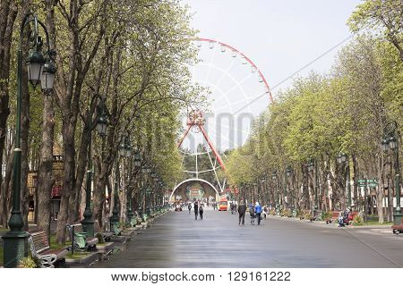 KHARKIV UKRAINE - APRIL 17 2016: On the central alley at Gorky Park in Kharkiv in the morning after rain