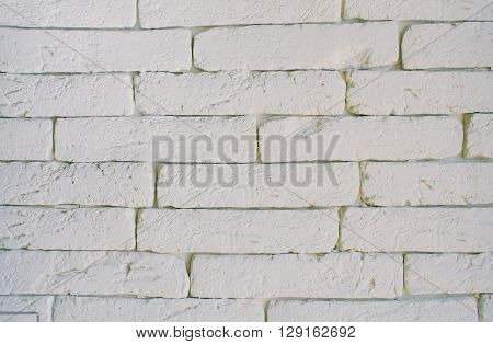 White grunge brick wall background. Background of brick wall texture. Abstract weathered texture stained old stucco light gray paint white brick wall background. Horizontal architecture wallpaper.