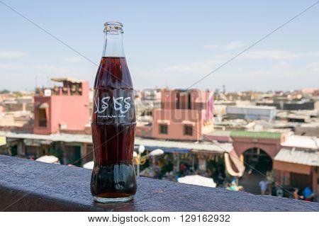MARRAKECH MOROCCO - APR 29 2016: Classic bottle of Coca-Cola with Arabic logo.