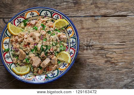 Fresh quinoa and cuscus salad on decorated bowl ready for eat