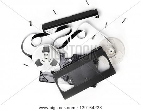 Video Cassette tape or VHS video cartridge exploded in to parts. Isolated on white.