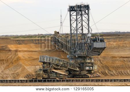 Bucket wheel excavator in a brown coal open pit mine.